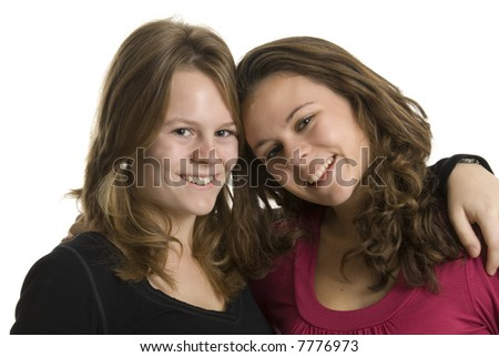 a portrait of two smiling teenage sisters