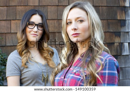 A portrait of two, young, hip, female friends. - stock photo
