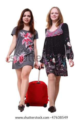 A portrait of two young pretty girls pulling a big red bag - stock photo