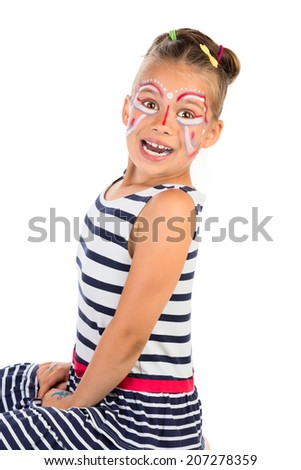 A portrait of very excited young girl with abstract face painting applied, isolated - stock photo