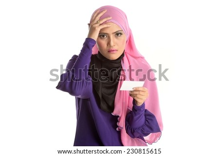 a portrait of young beautiful asian muslim woman holding a card in case of headache - stock photo