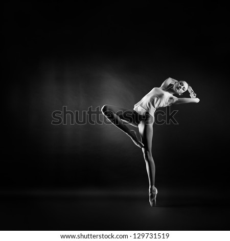 A portrait of young beautiful gymnast woman - stock photo