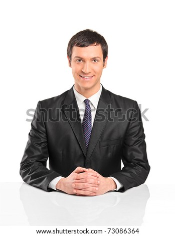 A portrait of young businessman sitting during an interview isolated against white background - stock photo