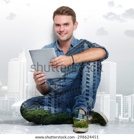 A portrait of young caucasian man sitting on the floor holding a tablet pc. multi exposure photo - stock photo