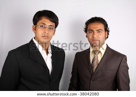 A portrait of young Indian businessmen in office. - stock photo