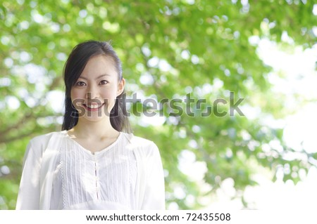 a portrait of young woman in the forest