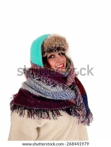 A portrait picture of a woman with a big scarf around her neck and head, dressed for very cold weather, isolated for white background.  - stock photo