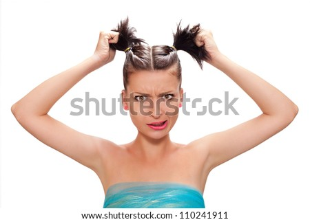 A portrait picture of a young frustrated woman pulling out hair isolated on white - stock photo