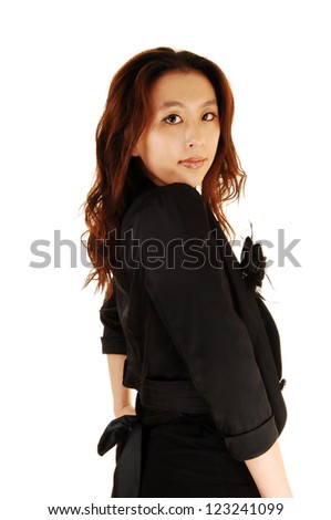 A portrait shot in closeup of a beautiful Asian woman in a black dress and brunette hair for white background.