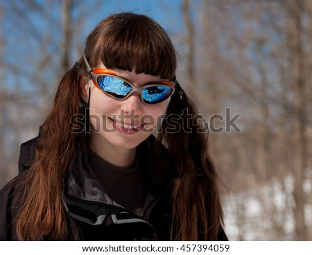 A portrait woman smile white teeth with sunglasses. Beautiful  mountain day winter.  Holiday sport background.  - stock photo