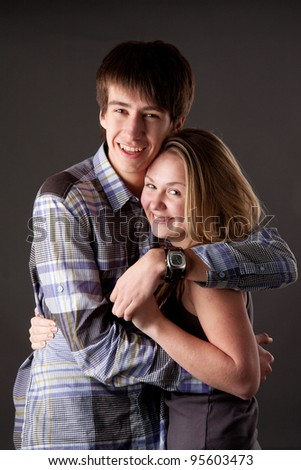 A portraits of young happy couple in studio