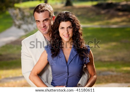 A portriat of a happy couple in the park. - stock photo
