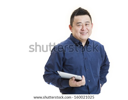 A positive Asian male office worker front view holding tablet on isolated white background. - stock photo