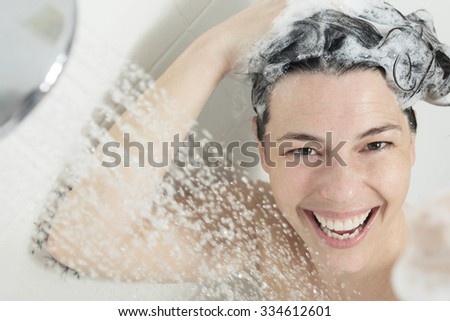 A positive thumb up woman with big smile on shower. - stock photo
