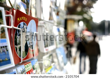 A postcard stand on a sidewalk in France - shallow depth of field. - stock photo