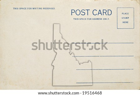 A postcard with an Idaho map outline. Dirt and scratches at 100%.