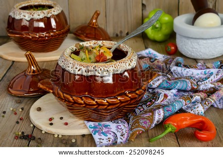 A pot of chicken and mushrooms. Chicken, potatoes and vegetables stewed in a pot  - stock photo