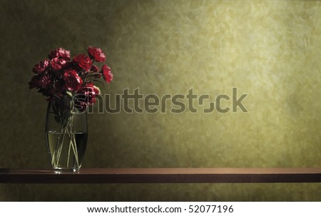 a pot of flower on a wooden shelf - stock photo