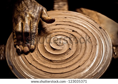 A potter completing his work - stock photo