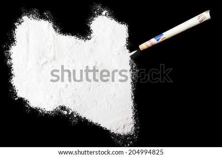 A powder drug like cocaine in the shape of Libya with a rolled money bill.(series) - stock photo