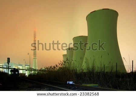 A power plant - night fog shot - stock photo