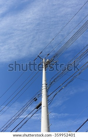 a power pole in a blue sky