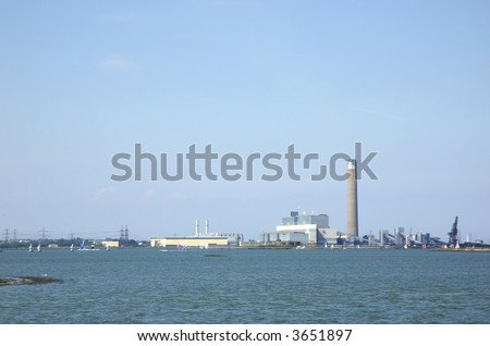 A power station across the river medway in England - stock photo