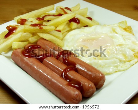 a powerful breakfast whit egg, sausage and fried - stock photo