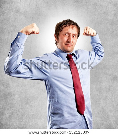A powerful businessman showing his strength - stock photo