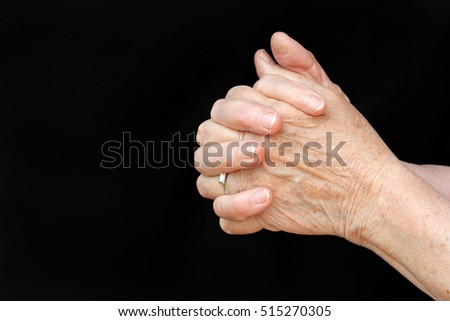 A praying old woman