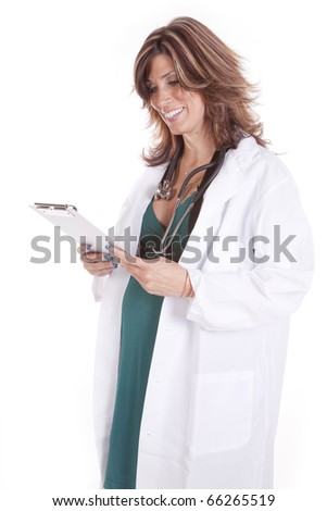 a pregnant woman doctor in her white lab coat looking at a chart.