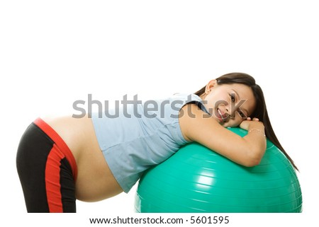 A pregnant woman doing a breathing exercise with an exercise ball - stock photo