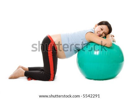 A pregnant woman doing relaxation with birth ball - stock photo