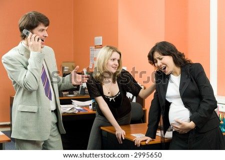 A pregnant woman having some contractions in the office