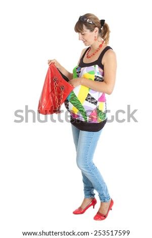 A pregnant woman (9 months) opening a red bag - stock photo