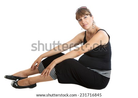 A pregnant woman, 9 months, sits - stock photo