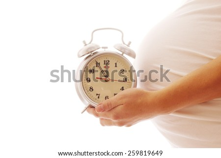 a pregnant woman on a white background - stock photo
