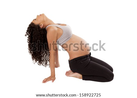 A pregnant woman tilts her head back during a relaxing stretch, isolated on white background. - stock photo
