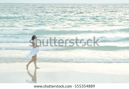a pregnant woman walking on the beach,pastel style