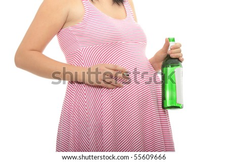 A pregnant woman with alcohol and cigarette - stock photo
