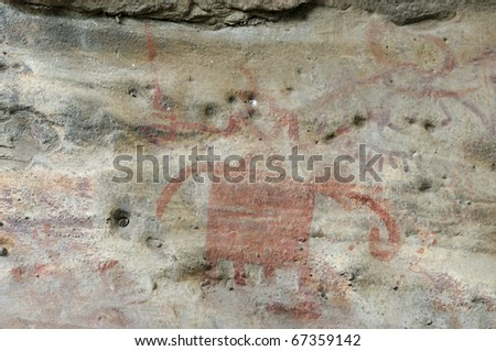 A prehistoric  abstract cave painting in Bhimbetka -India , a world heritage site. - stock photo