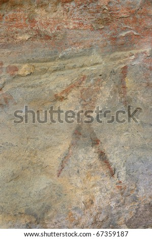 A prehistoric cave painting in Bhimbetka -India , a world heritage site which shows a faded out painting of a man without his head. - stock photo