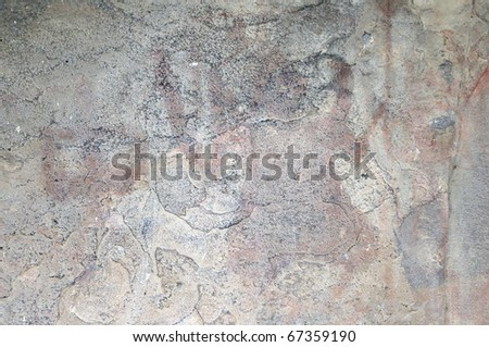 A prehistoric cave painting in Bhimbetka -India , a world heritage site which shows a faded out painting. - stock photo