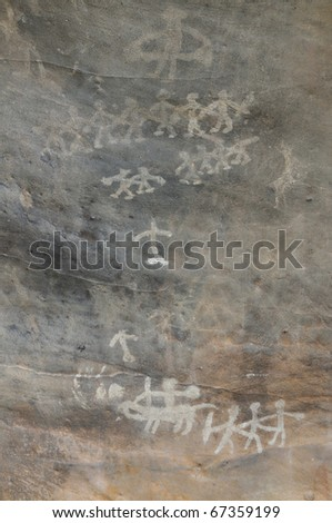 A prehistoric cave painting in Bhimbetka -India , a world heritage site which shows a festive atmosphere. - stock photo