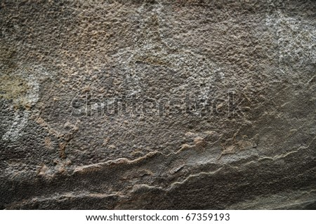 A prehistoric cave painting in Bhimbetka -India , a world heritage site which shows a horse. - stock photo