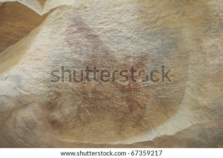 A prehistoric cave painting in Bhimbetka -India , a world heritage site which shows a horse up on his back toes. - stock photo