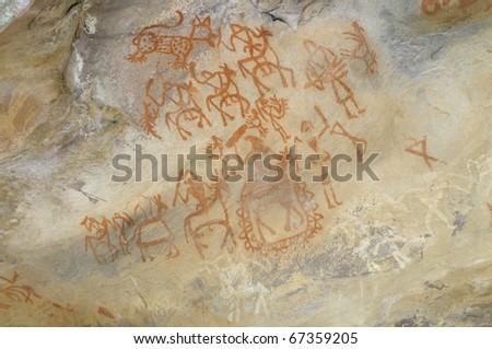 A prehistoric cave painting in Bhimbetka -India , a world heritage site which shows a king  traveling with his soldiers. - stock photo