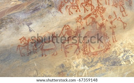 A prehistoric cave painting in Bhimbetka -India , a world heritage site which shows  a king along with his soldiers. - stock photo