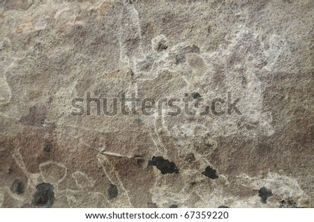 A prehistoric cave painting in Bhimbetka -India , a world heritage site which shows a soldier on his horse with his weapon in his hand and fighting. - stock photo