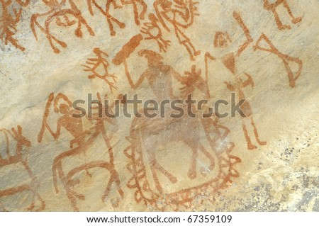 A prehistoric cave painting in Bhimbetka -India , a world heritage site which shows a war scene. - stock photo